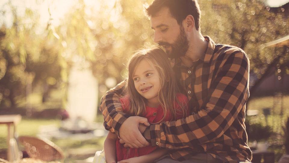 Dad hugging little girl