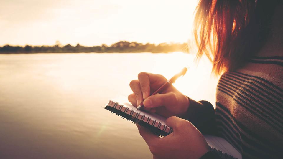 Newsroom Imagery - woman writing by a lake