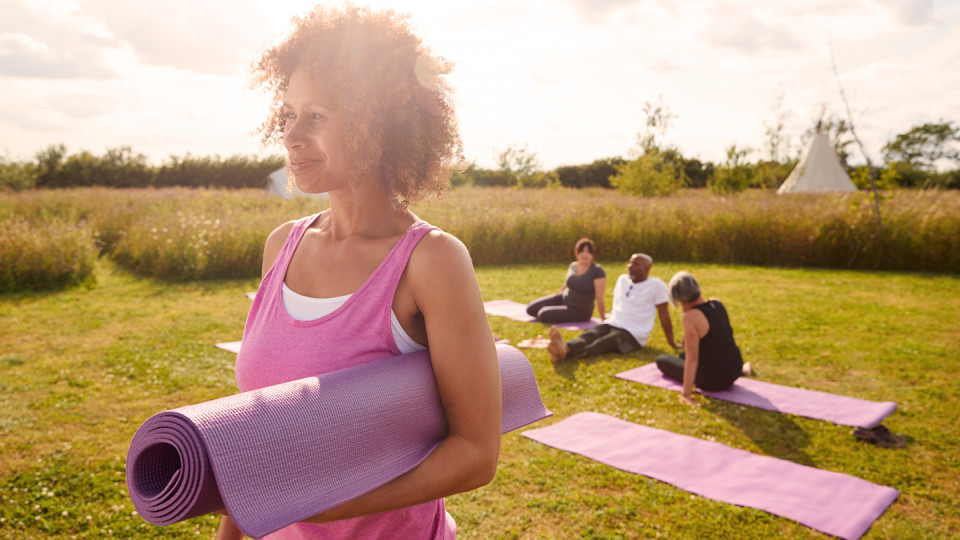 Woman in pink with yoga mat