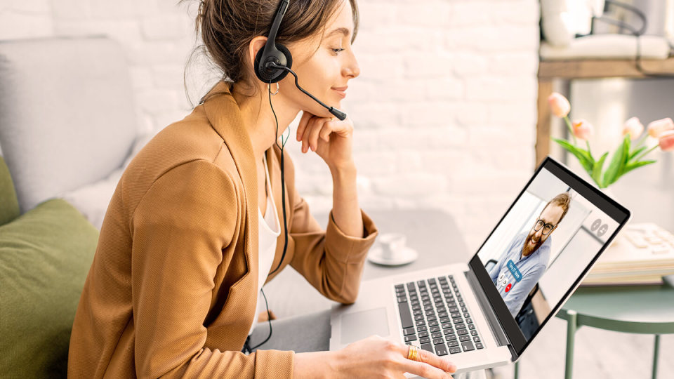 Business woman having a video call with co-worker, working online from home at cosy atmosphere. Concept of remote work from home.