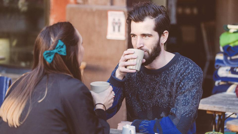 Two friends having coffee