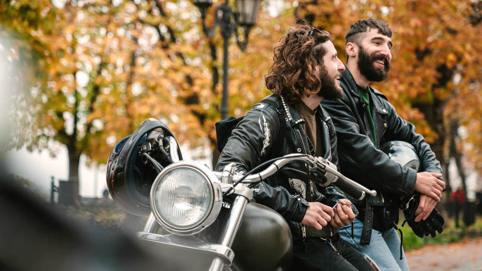 Two men with motorcycle / motorbike