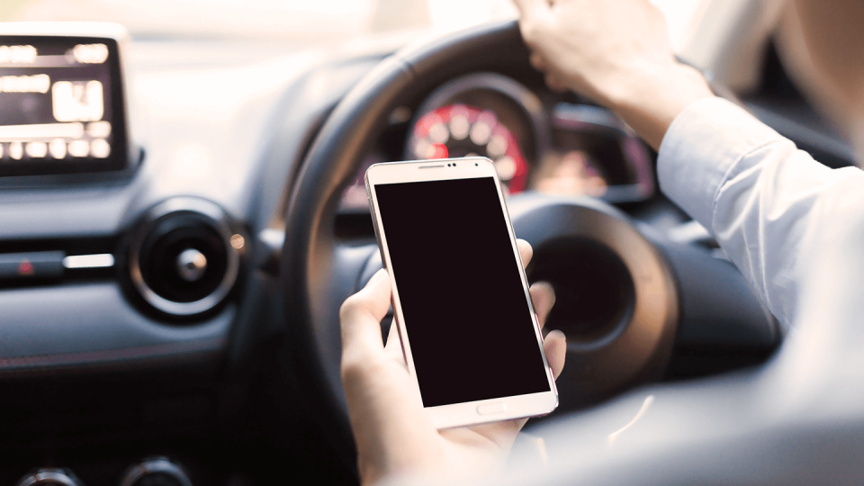 Man on mobile phone while driving