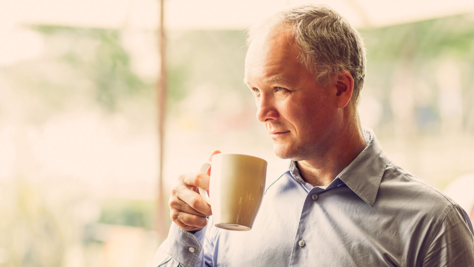 Closeup of Pensive Middle-aged Man Drinking Tea