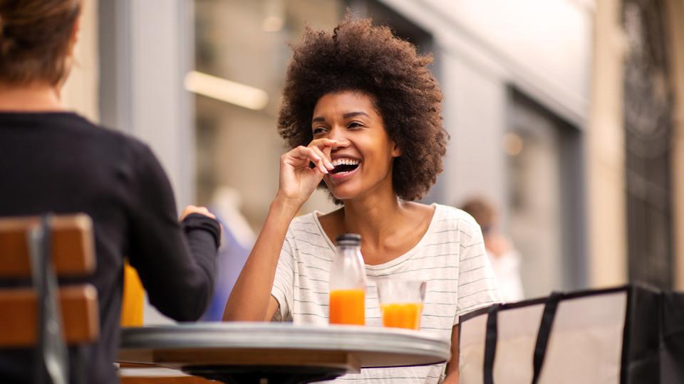 Woman drinking orange juice outside