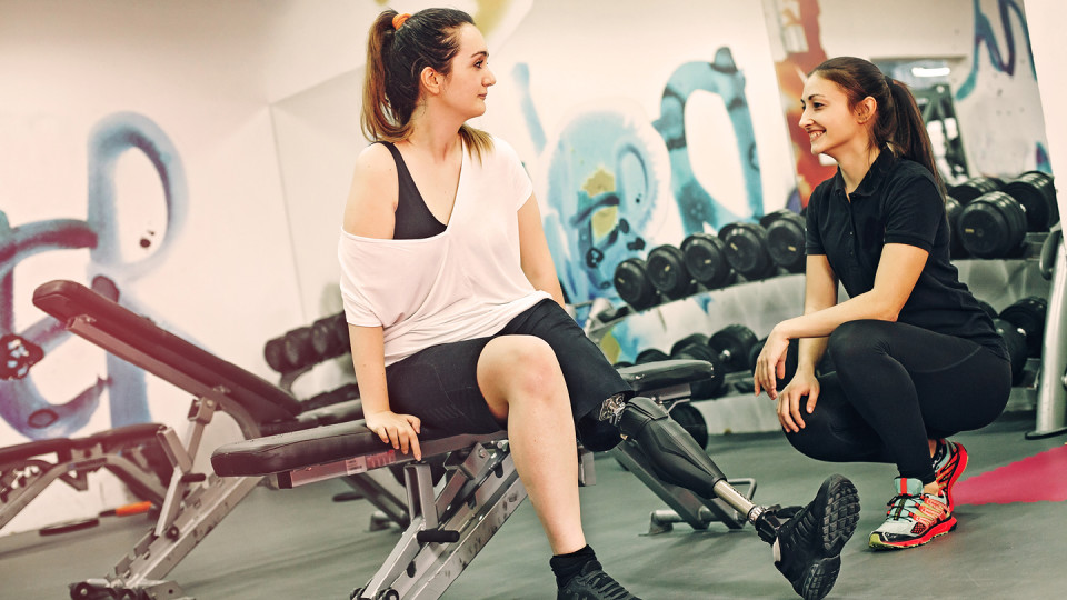 Woman with amputation in gym
