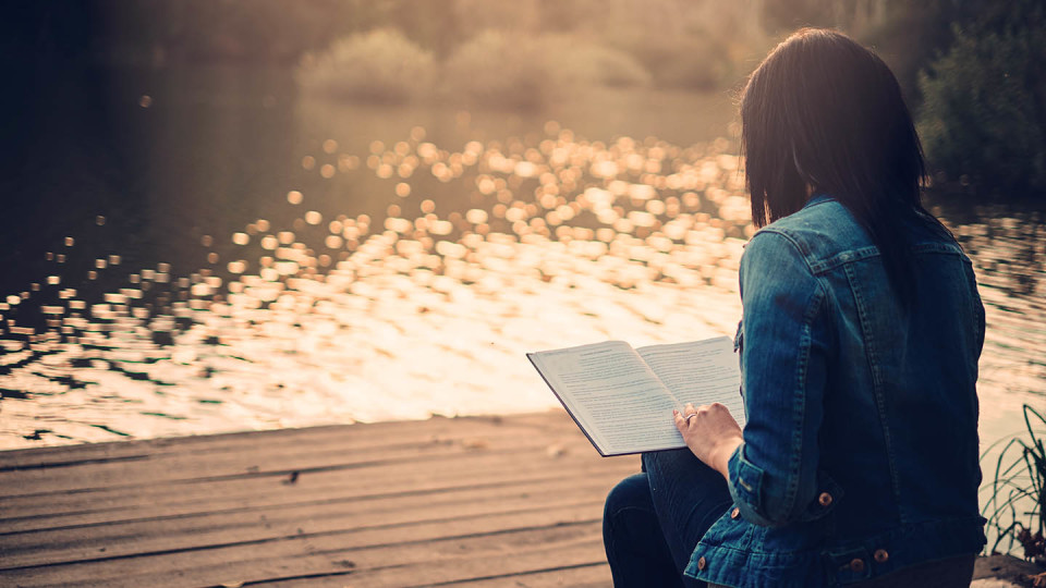 Newsroom Image - woman reading by lake