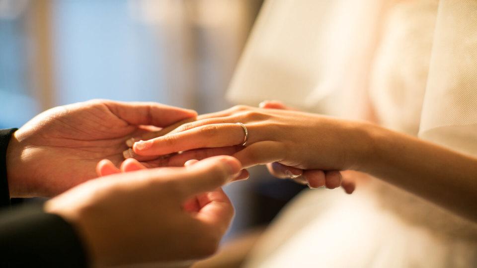 Husband holding wife's hand