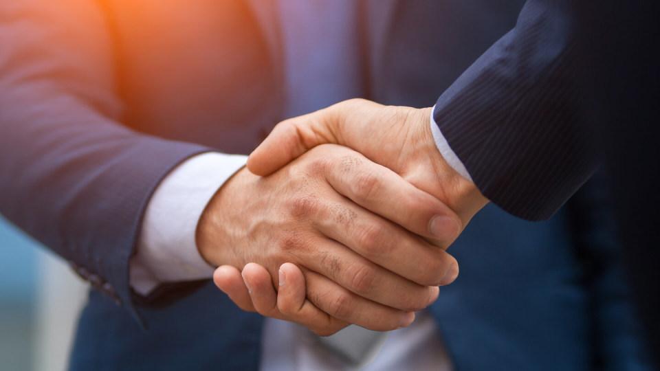 Newsroom - Hand shake