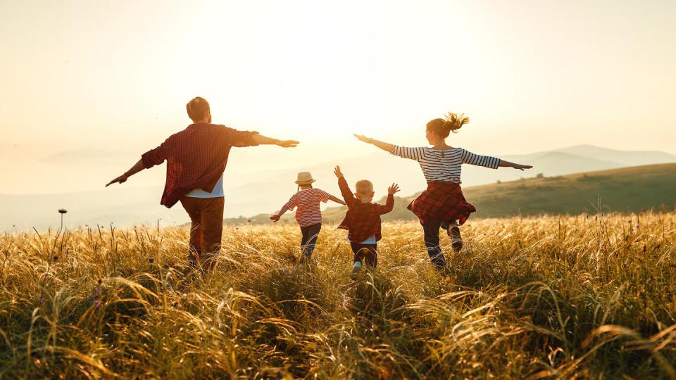 Newsroom - Family running on a hill
